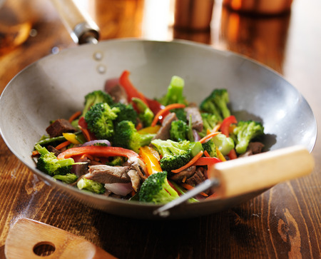 chinese stir fry in metal wok