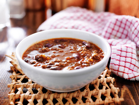 bowl of chili cooling on table photo