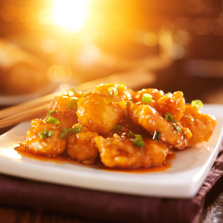 chinese take out sesame chicken in orange light