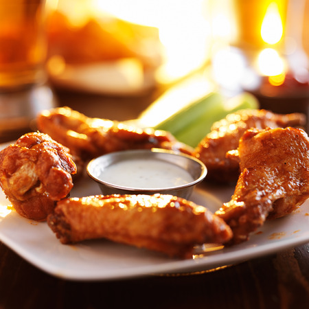 buffalo barbecue hot chicken wings around ranch sauce with celery Stock Photo