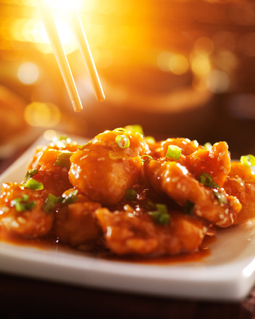 take out food: eating chinese food - sesame chicken Stock Photo