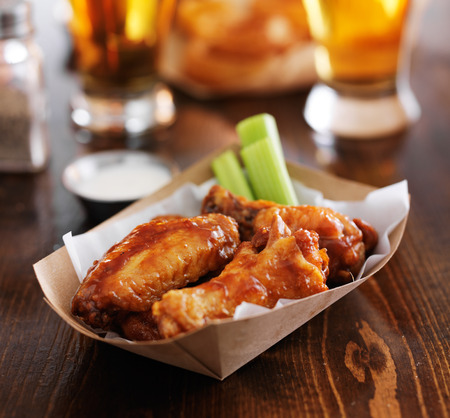 hot bbq buffalo chicken wings with ranch sauce and celery Stock Photo