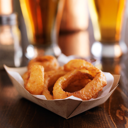 basket of fresh onion rings with beer