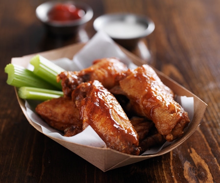 spicy: basket of buffalo chicken wings with celery and ranch Stock Photo