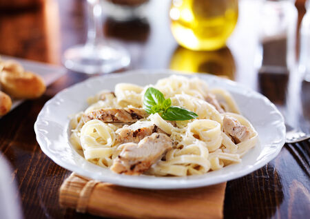 grilled chicken with fettuccine alfredo pasta photo
