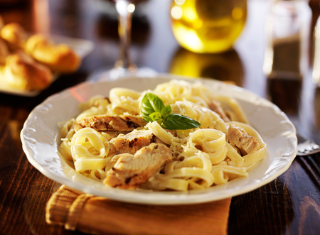 fettuccine: fettuccine alfredo pasta with grilled chicken at night time dinner