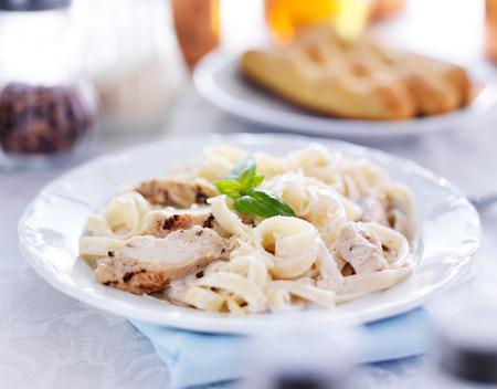 italian fettuccine alfredo pasta with grilled chicken dinner photo