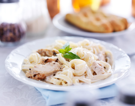 meat dish: italian fettuccine alfredo pasta with grilled chicken dinner Stock Photo