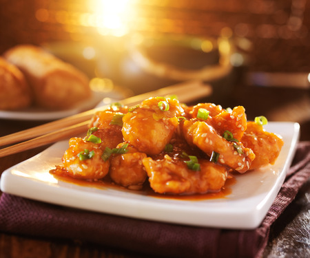 chinese food - sesame chicken with chopsticks Archivio Fotografico