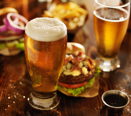 beer with hamburgers on restaurant table photo