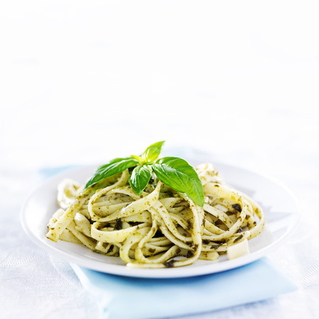pesto pasta with basil shot in copy space composition