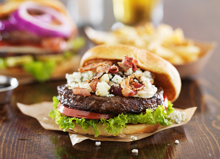 gourmet burgers on wooden table with bleu cheese and bacon Stock Photo