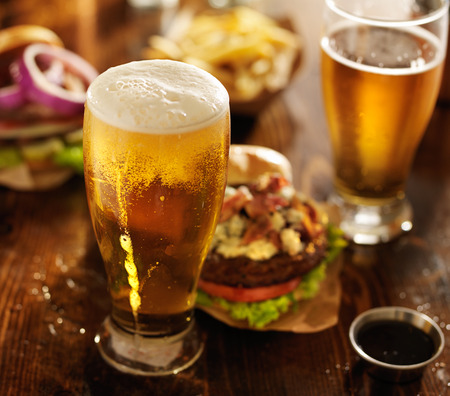 close up food: beer with hamburgers on restaurant table Stock Photo
