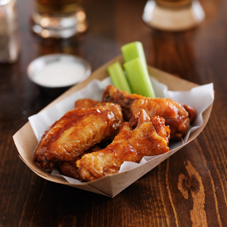 basket: barbecue buffalo chicken wings with celery sticks and ranch sauce Stock Photo