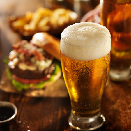 beer with hamburgers on restaurant table 스톡 콘텐츠