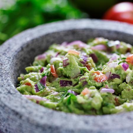 guacamole: mexican guacamole in stone molcajete