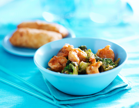 close up food: chinese shrimp stir fry in colorful table setting
