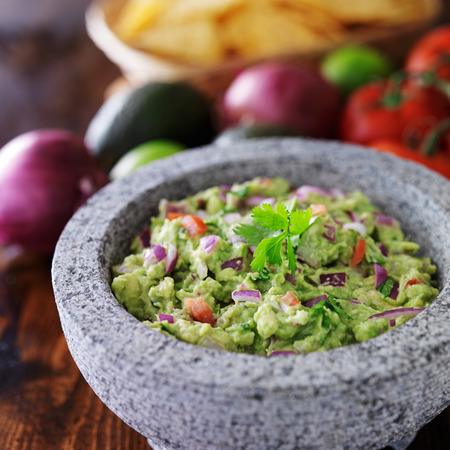 raw food: mexican guacamole in stone molcajete