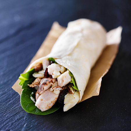 chicken spinach mushroom wrap on slate Banco de Imagens