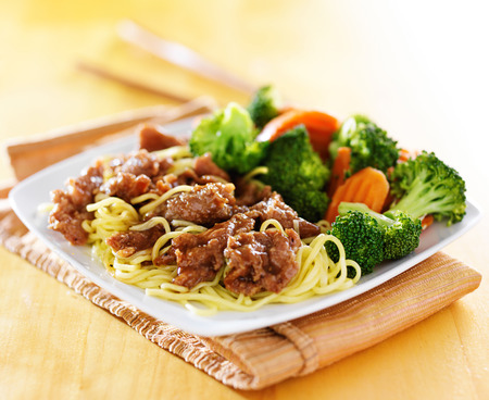 teriyaki beef and noodles dish with vegetables photo