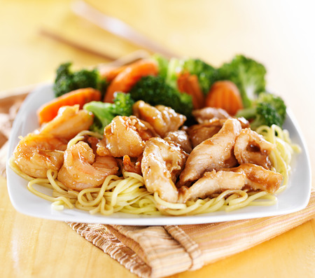 japanese chicken and shrimp teriyaki on noodles Stock Photo