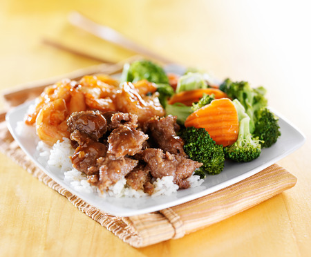 beef and shrimp teriyaki combination on white rice