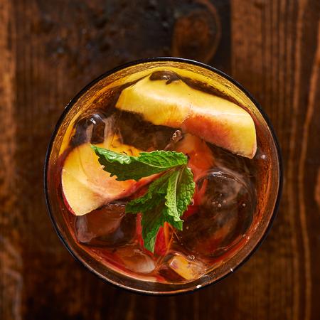 iced peach tea cocktail over head photo