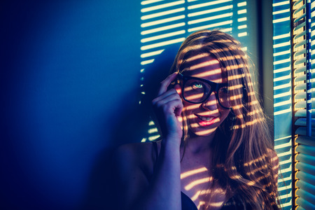 slits: surreal colored image with sexy girl staring at camera