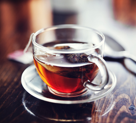 teabag: steeping teabag in glass cup Stock Photo