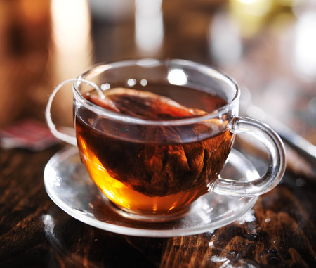 teabag: hot cup of tea steeping in glass Stock Photo