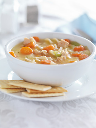 chicken noodle soup: chicken noodle soup with crackers and copysapce composition