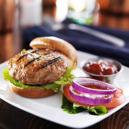 meat alternatives: turkey burger on bun with lettuce and fixings