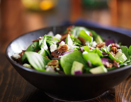 spinach salad: avocado spinach salad with feta cheese, pecans and bacon
