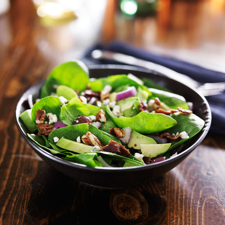 avocado spinach salad with feta cheese, pecans and bacon