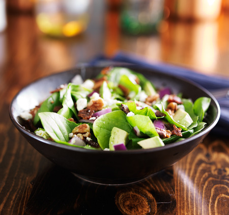 spinach and avocado chopped salad in bowl photo
