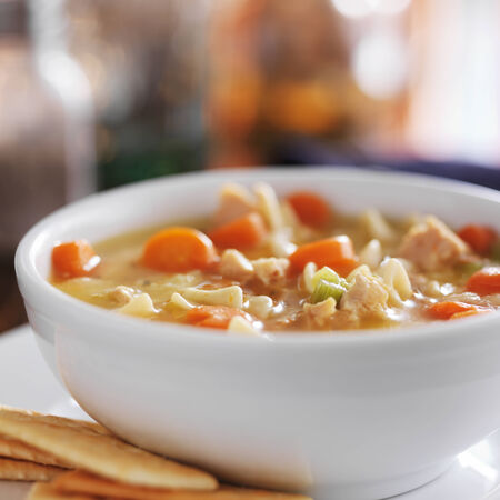 chicken noodle soup: chicken noodle soup with crackers close up Stock Photo