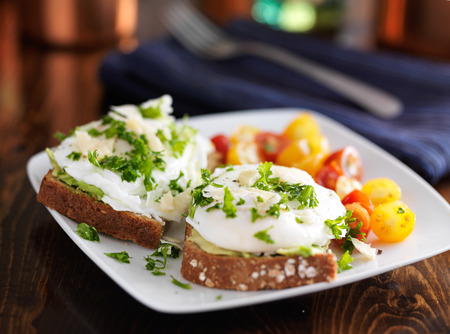 poached eggs and avocado on toast with tomatoestoes