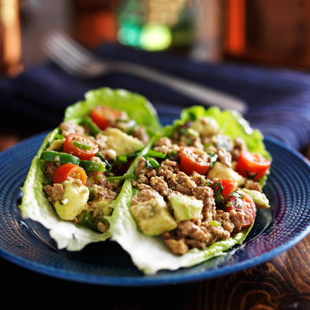 romaine: avocado turkey lettuce wraps on plate