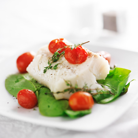 halibut: halibut on spinach on white plate Stock Photo