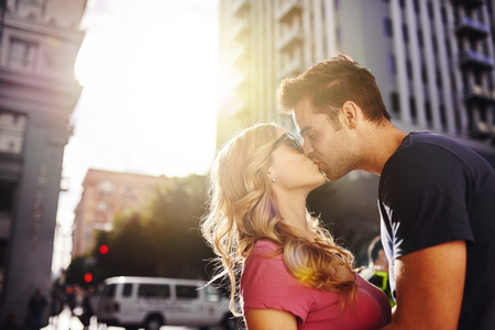 romantic couple kissing in downtown los angeles photo
