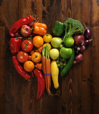 vegetables on cutting board shaped like heart photo