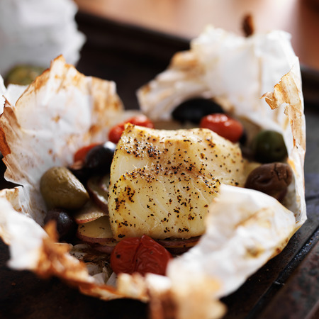 potato cod: mediterranean cod packet with vegetables Stock Photo