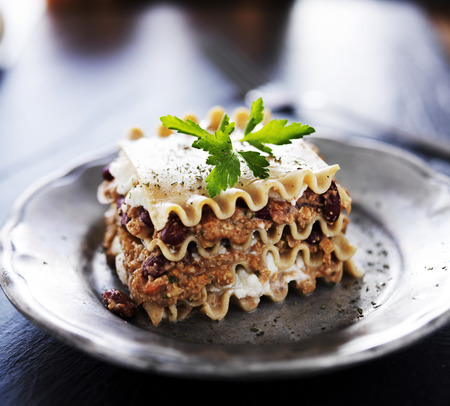 meat and alternatives: vegan lasagna with cheese and meat alternatives
