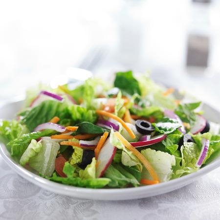 garden salad on white table cloth