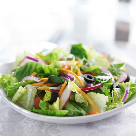 garden salad on white table cloth