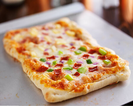 baking tray: homemade baked pizza on baking sheet