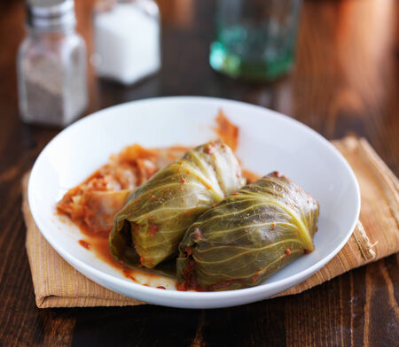 cabbage rolls on plate on top of table Banco de Imagens - 36104691