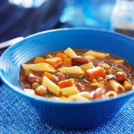 minestrone: minestrone soup in blue bowl close up Stock Photo