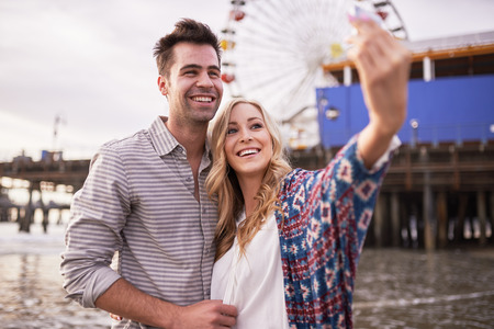 romantic couple: romantic couple taking selfies together in santa monica