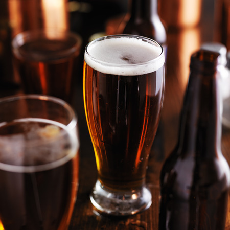 dark: dark beer in tall glass on wooden table Stock Photo
